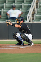 Kannapolis Intimidators catcher Ryan Plourde (28) warms up his pitcher prior to the start of the South Atlantic League game against the Lakewood BlueClaws at Intimidators Stadium on July 16, 2015 in Kannapolis, North Carolina.  The BlueClaws defeated the Intimidators 3-1.  (Brian Westerholt/Four Seam Images)