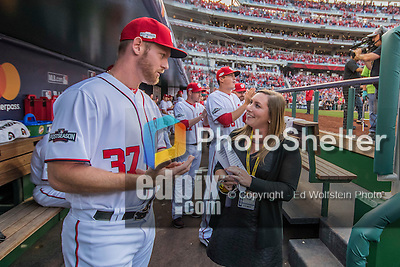 7 October 2016: Washington Nationals Senior Director of Communications Amanda Comak chats with pitcher Stephen Strasburg before his introduction, prior to the first game of the NLDS between the Washington Nationals and the Los Angeles Dodgers at Nationals Park in Washington, DC. The Dodgers edged out the Nationals 4-3 to take the opening game of their best-of-five series. Mandatory Credit: Ed Wolfstein Photo *** RAW (NEF) Image File Available ***