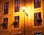A streetlight illuminates windows and floweboxes, around one of the many small piazzas scattered around Rome, Italy.