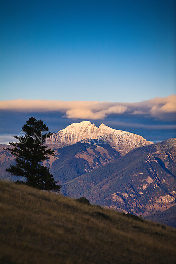 The last light of the day on the peaks of the Mission Mountains in western Montana