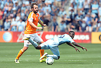 Adam Moffat (16) midfield Houston Dynamo , Peterson Joseph (19) midfield Sporting KC ..Sporting Kansas City and Houston Dynamo played to a 1-1 tie at Sporting Park, Kansas City, Kansas.