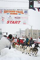 XX leaves the 2011 Iditarod ceremonial start line in downtown Anchorage, during the 2012 Iditarod..Jim R. Kohl/Iditarodphotos.com
