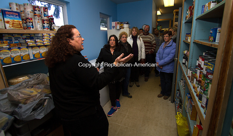 TORRINGTON, CT - 21 NOVEMBER 2015 -112115JW02.jpg -- FISH NWCT Food Pantry Manager Margaret Franzi explains the needs of the pantry to a group taking the tour of the of the FISH NWCT house during an open house Saturday morning.  Jonathan Wilcox Republican-American