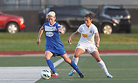 Boston Breakers midfielder Joanna Lohman (11) controls the ball as Western New York Flash midfielder Carli Lloyd (10) pressures. In a National Women's Soccer League Elite (NWSL) match, the Boston Breakers (blue) tied Western New York Flash (white), 2-2, at Dilboy Stadium on June 5, 2013.
