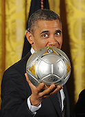 United States President Barack Obama holds a soccer ball as he welcome the Stanley Cup champion Los Angeles Kings and the Major League Soccer champion LA Galaxy to the White House to honor their 2012 championship seasons in a ceremony in the East Room of the White House March 26, 2013 in Washington, DC. .Credit: Olivier Douliery / Pool via CNP