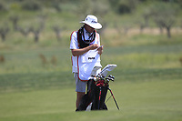 Kenneth Quillan caddy for Eunshin Park (KOR) in deep thought on the 9th during Round 2 of the Rocco Forte Sicilian Open 2018 on Friday 11th May 2018.<br /> Picture:  Thos Caffrey / www.golffile.ie<br /> <br /> All photo usage must carry mandatory copyright credit (&copy; Golffile | Thos Caffrey)