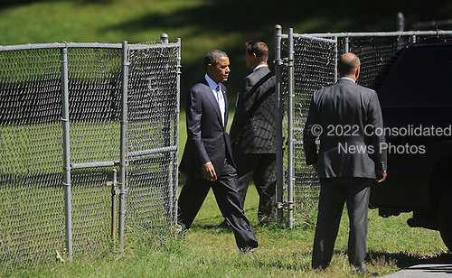 United States President Barack Obama arrives at Walter Reed National Military Medical Center to visit Wounded Warriors and their families on September, 11, 2012 in Bethesda, Maryland..Credit: Olivier Douliery / Pool via CNP