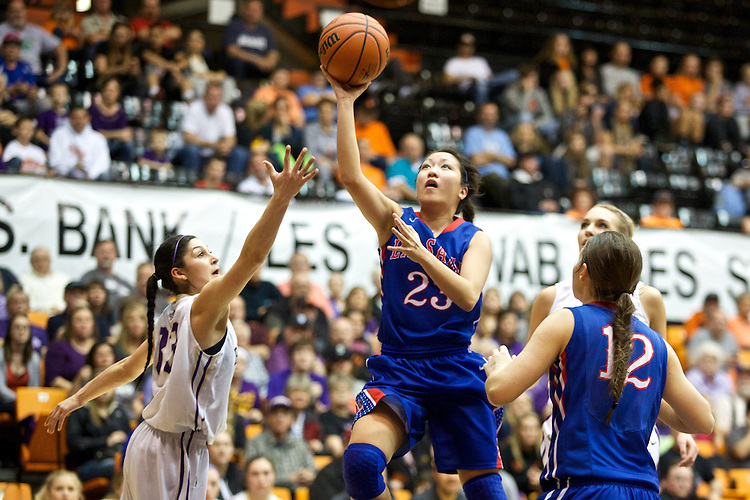Mar 11, 2015; Portland, OR, USA;  La Salle Prep guard Shannon Tran shoots over Hermiston Bulldogs guard Sara Ramirez in the 5A Girls Basketball State Championship at Gill Coliseum.<br /> Photo by Jaime Valdez