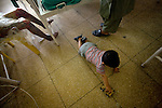 A toddler plays on the floor of a burn unit at Mirwais Hospital in Kandahar, Afghanistan, April 23, 2009. Despite worsening security, development continues at Mirwais Hosptial, where the International Committe of the Red Cross conducts training and assists the local staff. Mirwais is the main public hosptial serving five southern provinces. As security has deteriorated in the South, many international NGO's have pulled their staff from the area or shut down the regional office, stunting development in a region where it is badly needed.