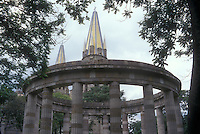 The Rotonda de las Hombres Jalicenses Ilustres or Rotunda of Illustrious Jaliscans monument with the Guadalajara cathedral spires in back, Guadalajara, Jalisco, Mexico