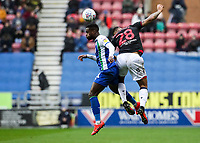 Bolton Wanderers' Josh Magennis competing with Wigan Athletic's Gavin Massey <br /> <br /> Photographer Andrew Kearns/CameraSport<br /> <br /> The EFL Sky Bet Championship - Wigan Athletic v Bolton Wanderers - Saturday 16th March 2019 - DW Stadium - Wigan<br /> <br /> World Copyright &copy; 2019 CameraSport. All rights reserved. 43 Linden Ave. Countesthorpe. Leicester. England. LE8 5PG - Tel: +44 (0) 116 277 4147 - admin@camerasport.com - www.camerasport.com
