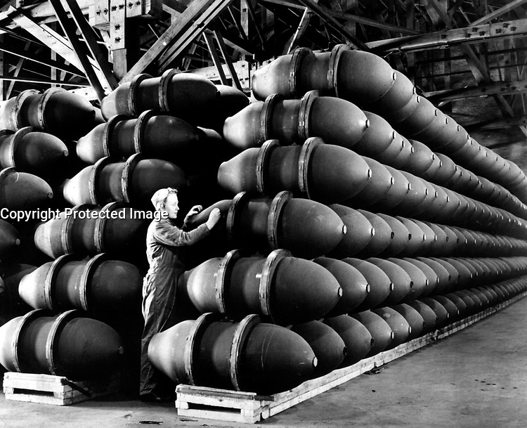 A woman war worker checks over 1,000 pound bomb cases before they are filled with deadly charges of explosives and shipped off to Allied bases and battlefronts all over the world.  Firestone Tire and Rubber Co.  Omaha, NE, ca.  May 1944. Acme.  (OWI)<br /> Exact Date Shot Unknown<br /> NARA FILE #:  208-AA-352AA-5<br /> WAR &amp; CONFLICT BOOK #:  817