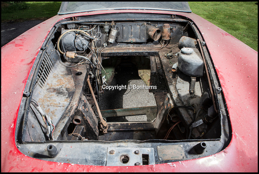 BNPS.co.uk (01202 558833)<br /> Pic: Bonhams/BNPS<br /> <br /> Engine bay is without the engine at the moment.<br /> <br /> Yours for £180,000 - The Aston Martin jigsaw found in a barn.<br /> <br /> This Aston Martin may look like a lost cause, but fully restored this classic DB4 could be worth a cool £600,000. <br /> <br /> The vintage 1959 Aston Martin DB4 Series 1 comes with front wheels, seats, and even the engine unattached.<br /> <br /> But despite it's dilapidated state the motor is still an attractive proposition for petrol-heads, offering a unique chance to renovate a virtually untouched DB4.<br /> <br /> Bonhams' Beaulieu sale takes place on September 3.