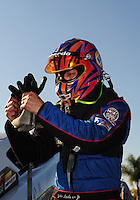 Feb. 10, 2012; Pomona, CA, USA; NHRA top alcohol funny car driver John Lombardo during qualifying at the Winternationals at Auto Club Raceway at Pomona. Mandatory Credit: Mark J. Rebilas-