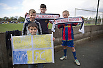 Vauxhall Motors FC 0 Solihull Moors 2, 26/04/2014. Rivacre Park, Conference North. Young supporters with scarves and a homemade banner pictured during Vauxhall Motors (in white) play Solihull Moors at Rivacre Park in the final Conference North fixture of the season. It was to be the last match for the Ellesmere Port-based home club, named after the giant car factory in the town, who have resigned from the professional pyramid system to return to local amateur football due to spiralling costs and low attendances. Their final match resulted in a 2-0 home defeat, watched by a crowd of only 215. Photo by Colin McPherson.