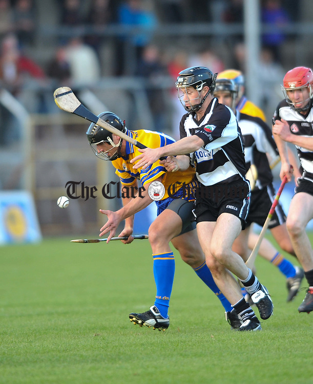 Tony Carmody of Sixmilebridge in action against Danny Scanlan of Clarecastle during their senior hurling championship game at Cusack park. Photograph by John Kelly