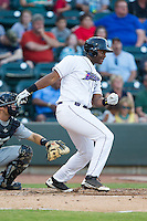 Keon Barnum (20) of the Winston-Salem Dash follows through on his swing against the Carolina Mudcats at BB&T Ballpark on June 6, 2014 in Winston-Salem, North Carolina.  The Mudcats defeated the Dash 3-1.  (Brian Westerholt/Four Seam Images)