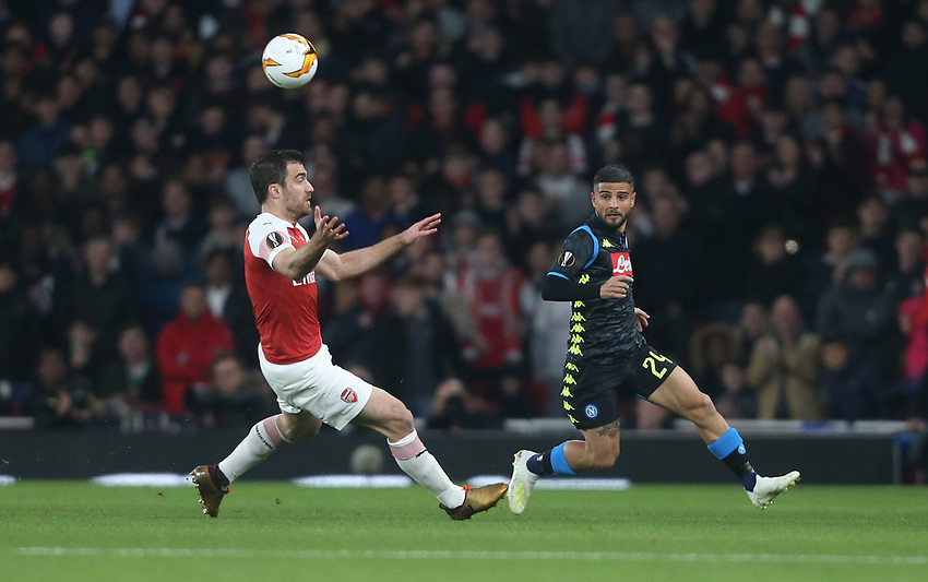 Napoli's Lorenzo Insigne and Arsenal's Sokratis Papastathopoulos<br /> <br /> Photographer Rob Newell/CameraSport<br /> <br /> UEFA Europa League First Leg - Arsenal v Napoli - Thursday 11th April 2019 - The Emirates - London<br />  <br /> World Copyright © 2018 CameraSport. All rights reserved. 43 Linden Ave. Countesthorpe. Leicester. England. LE8 5PG - Tel: +44 (0) 116 277 4147 - admin@camerasport.com - www.camerasport.com