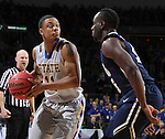 SIOUX FALLS, SD - MARCH 5:  George Marshall #11 of South Dakota State drives against Obi Emegano #15 of Oral Roberts in the 2016 Summit League Tournament.  (Photo by Dick Carlson/Inertia)
