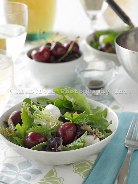 Baby Greens Salad with Fresh Cherries and Fresh Mozzarella on table