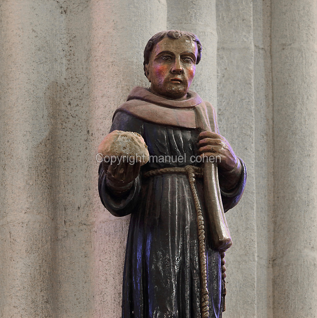 Jean Discalceat or Yann Divoutou, also known as Santig Du or Santik Du, breton Franciscan popular saint, 1279-1349, holding bread, sculpture in the Chapelle des Saints Anges, in Quimper Cathedral, or the Cathedrale Saint-Corentin de Quimper, a Gothic Roman Catholic cathedral founded in 1239 and completed in the 15th century, in Quimper, Finistere, Brittany, France. The cathedral is listed as a national monument. Picture by Manuel Cohen