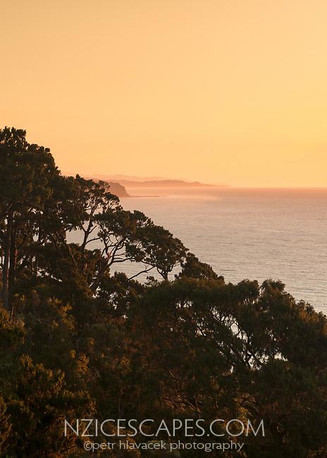 Sunset over Tasman Sea at Three Mile Lagoon near Okarito, Westland Tai Poutini National Park, UNESCO World Heritage Area, West Coast, New Zealand, NZ
