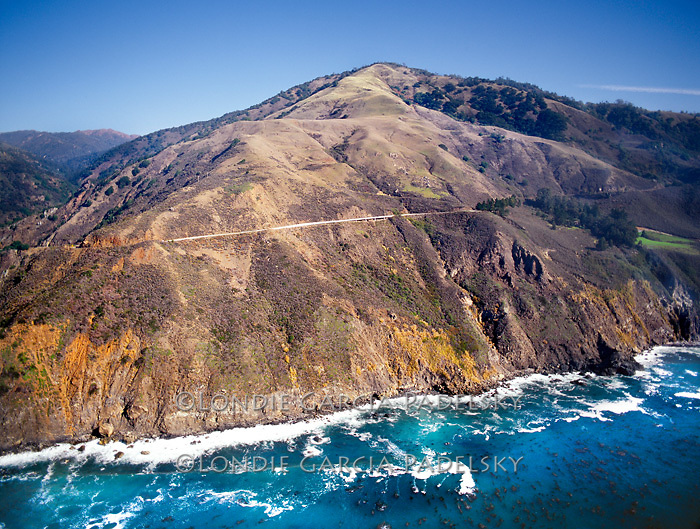 Scenic Highway 1 road cuts steeply into the Santa Lucia Mountains, Central Coast of California.A National Scenic Byway
