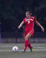Boston University midfielder Kylie Strom (9) at midfield. After 2 complete overtime periods, Boston College tied Boston University, 1-1, after 2 overtime periods at Newton Soccer Field, August 19, 2011.