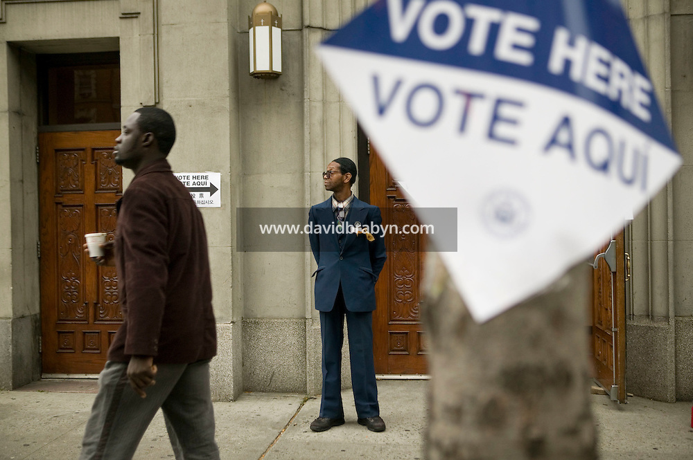 7 November 2006 - New York City, NY - A man stands outside a church serving as a polling station in Harlem, New York City, USA, 7 November 2006.
