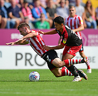 Lincoln City's Shay McCartan is fouled by Swindon Town's Steven Alzate<br /> <br /> Photographer Chris Vaughan/CameraSport<br /> <br /> The EFL Sky Bet League Two - Lincoln City v Swindon Town - Saturday 11th August 2018 - Sincil Bank - Lincoln<br /> <br /> World Copyright &copy; 2018 CameraSport. All rights reserved. 43 Linden Ave. Countesthorpe. Leicester. England. LE8 5PG - Tel: +44 (0) 116 277 4147 - admin@camerasport.com - www.camerasport.com