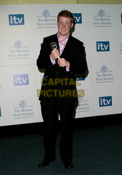 CHARLIE CLEMENTS.The British Soap Awards - Pressroom, .BBC Television Centre, London, England, .May 20th 2006..full length holding trophy award red and pink patterned floral print shirt .REf: AH.www.capitalpictures.com.sales@capitalpictures.com.©Adam Houghton/Capital Pictures.