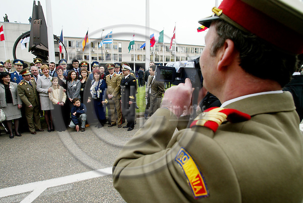 BRUSSELS - BELGIUM - 04 APRIL 2004--NATO celebration of the entry of the seven new member countries-- A Romanian officer making video of his colleges for a historic memory-- PHOTO: ERIK LUNTANG / EUP-IMAGES