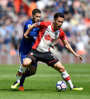 Southampton's Maya Yoshida (left) is tackled by Chelsea's Eden Hazard (right) <br /> <br /> Photographer David Horton/CameraSport<br /> <br /> The Premier League - Southampton v Chelsea - Saturday 14th April2018 - St Mary's Stadium - Southampton<br /> <br /> World Copyright &copy; 2018 CameraSport. All rights reserved. 43 Linden Ave. Countesthorpe. Leicester. England. LE8 5PG - Tel: +44 (0) 116 277 4147 - admin@camerasport.com - www.camerasport.com