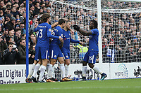 Eden Hazard of Chelsea (2nd right) celebrates after he scores his team's third goal of the game to make the score 3-1 during the Premier League match between Chelsea and Newcastle United at Stamford Bridge, London, England on 2 December 2017. Photo by David Horn.