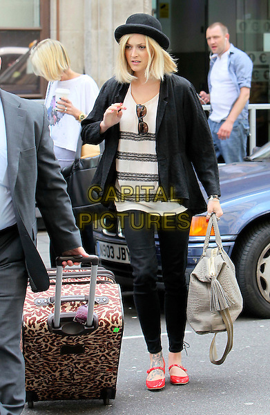 Fearne Cotton .leaving BBC Radio 1 studios to go to  Stanstead Airport, London, England, UK, 9th June 2011..full length black hat blazer jacket lace striped beige top trousers red patent shoes mary janes suitcase luggage animal leopard print .CAP/HIL.©John Hillcoat/Capital Pictures.