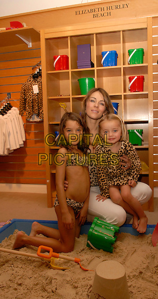 "ELIZABETH HURLEY.Launches her range of children's beachwear, ""Elizabeth Hurley Beach"" at Harrods, Knightsbridge, London, .December 6th 2007..half length Liz  leopard print top swimsuits sand sandpit sitting bikini.CAP/FIN.www.capitalpictures.com.©Steve Finn/Capital Pictures."