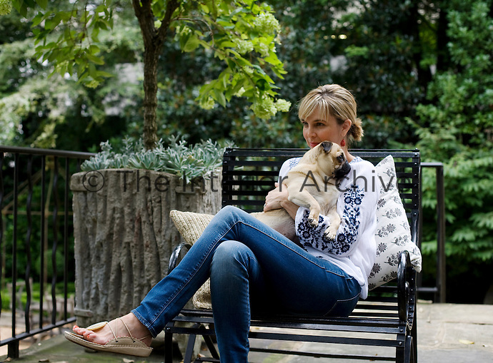Designer Jill Brinson with one of her three dogs