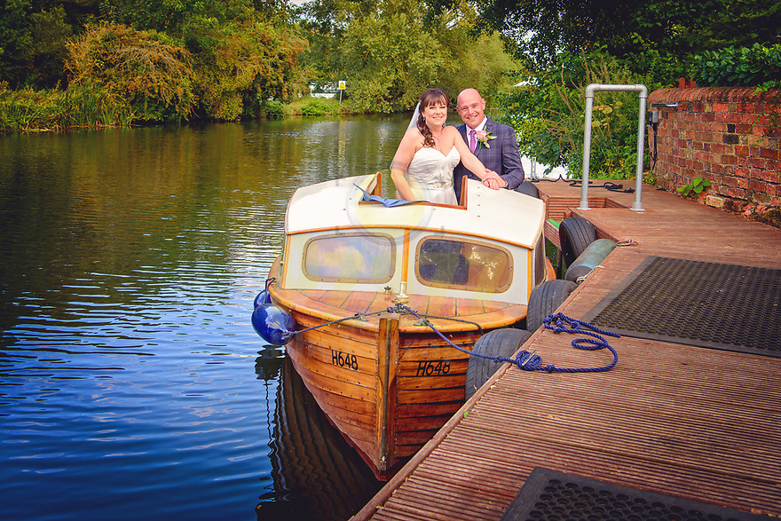 Bride and Groom on Brub on the River Great Ouse at the Barns Hotel, Bedford.