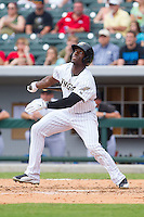 Jared Mitchell (21) of the Charlotte Knights follows through on his swing against the Pawtucket Red Sox at BB&T Ballpark on August 8, 2014 in Charlotte, North Carolina.  The Red Sox defeated the Knights  11-8.  (Brian Westerholt/Four Seam Images)