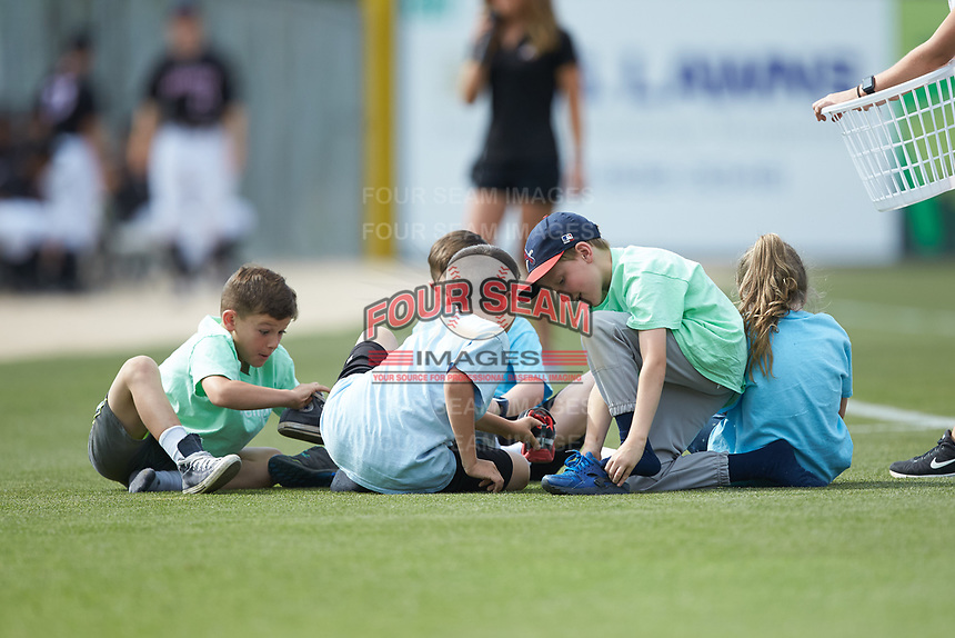 Young fans compete in a contest between innings of the South Atlantic League game between the Hagerstown Suns and the Kannapolis Intimidators where they need to find their sneakers and see who can put them on first at Kannapolis Intimidators Stadium on May 6, 2018 in Kannapolis, North Carolina. The Intimidators defeated the Suns 4-3. (Brian Westerholt/Four Seam Images)