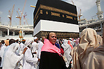 Muslim pilgrims circumventing around the holly Kaaba located in the center of the Haram Sharif Great Mosque, during the Muslim's Hajj 2014 pilgrimage, in Mecca, Saudi Arabia, 25 September 2014. According to the Muslims holly book the Koran, the Kaaba was built by Abraham and his son Ismael, after Ismael had settled in Arabia. Millions of Muslims have arrived in Saudi Arabia to perform their Hajj. Photo by Ashraf Amra