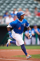 Oklahoma City Dodgers second baseman Willie Calhoun (4) runs to first base after hitting a single during a game against the Colorado Springs Sky Sox on June 2, 2017 at Chickasaw Bricktown Ballpark in Oklahoma City, Oklahoma.  Colorado Springs defeated Oklahoma City 1-0 in ten innings.  (Mike Janes/Four Seam Images)