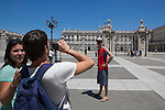 Tourists take photos in front of the `Palacio Real de Madrid´ Madrid´s Royal Palace in Madrid, Spain. Today, King Juan Carlos of Spain made a public announcement of his abdication will, his son, Prince Felipe of Spain, will become Spain´s king after the official ceremony. June 02, 2013. (ALTERPHOTOS/Victor Blanco)