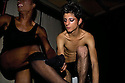 Renowned Palestinian drag queen 'Eman' prepares backstage with his protegee in a gay club in Jerusalem--frequented by Israeli and Palestinian drag queens , where the only wall between the people is a dressing room..