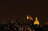 les invalides dome and sacre coeur church at night, paris, france