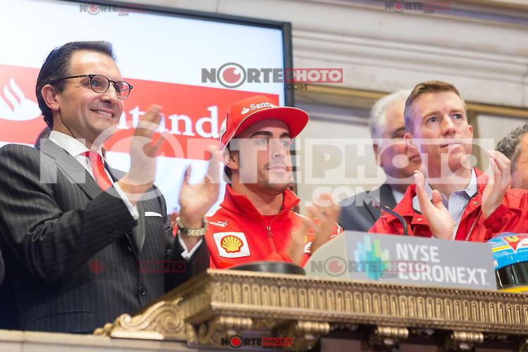 NEW YORK, NY - NOVEMBER 20:  Jorge Moran, President & CEO of Sovereign Bank, N.A. and Santander U.S. Country Head along with Fernando Alonso, Scuderia Ferrari Team Driver, rings the closing bell at the New York Stock Exchange on November 20, 2012 in New York City. (Photo by Ben Hider/NYSE Euronext)(ALTERPHOTOS/Pool)
