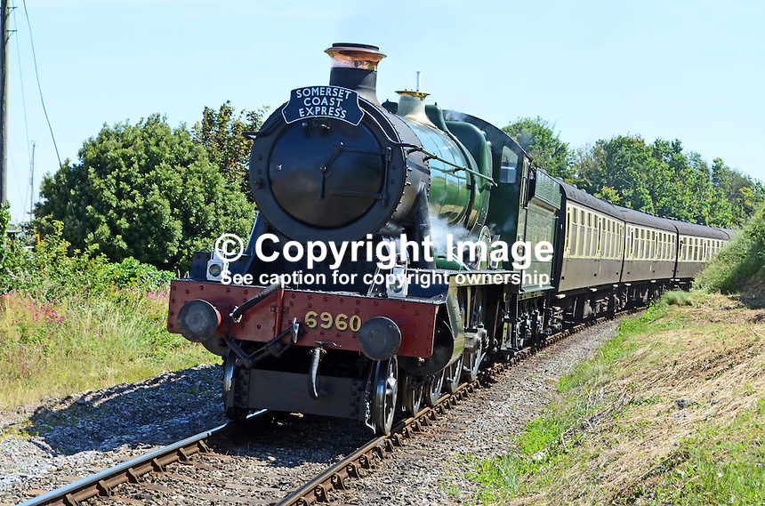 Locomotive, Raveningham Hall, No 6960, approaching Watchet station on its journey from Bishops Lydeard to Minehead.  West Somerset Railway, UK, July, 2014, 201407093450<br />