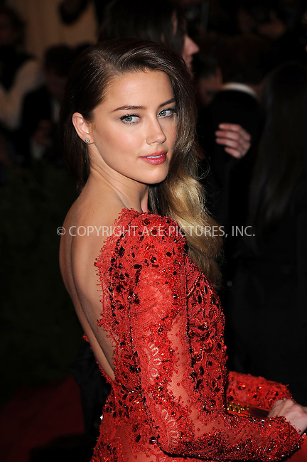 WWW.ACEPIXS.COM....May 6 2013, New York City....Amber Heard arriving at the Costume Institute Gala for the 'PUNK: Chaos to Couture' exhibition at the Metropolitan Museum of Art on May 6, 2013 in New York City.....By Line: Kristin Callahan/ACE Pictures......ACE Pictures, Inc...tel: 646 769 0430..Email: info@acepixs.com..www.acepixs.com