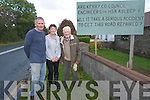 The Looney family have become so frustrated at Kerry County Council's inaction on the main Killarney to Mallow Road that they have erected a sign hitting out at the authority. <br /> L-R Tim, Cait and Dan Looney.