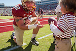 Offensive lineman Bryan Stork retrieves a ball prior to the start of the Florida State Seminoles defeat of the North Carolina State Wolfpack 49-17 in their NCAA football game  in Tallahassee, Florida.